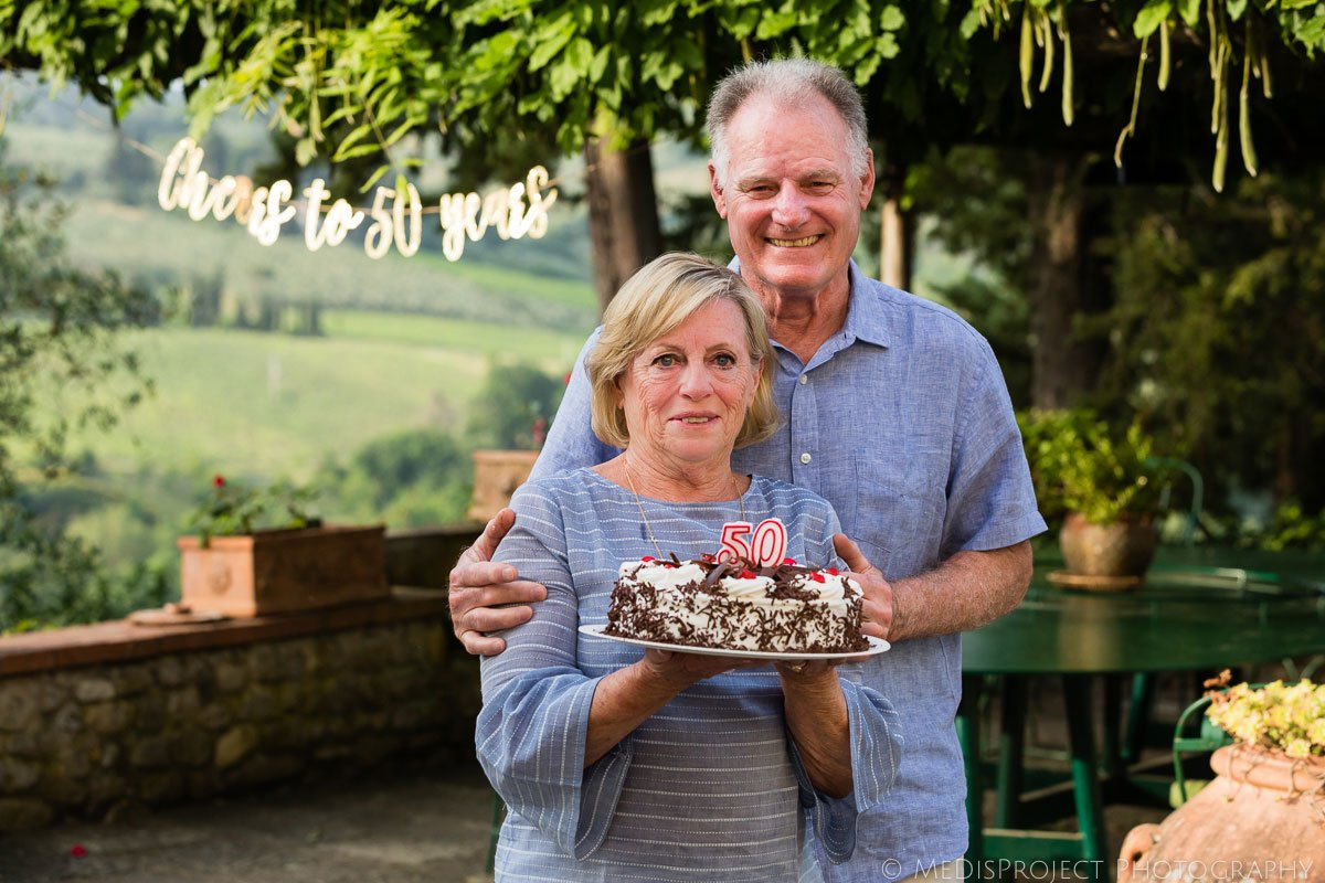 senior couple celebrating their wedding anniversary in Tuscany