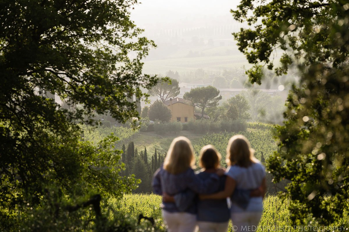 Mother and daughters moment during a photoshoot in Tuscany