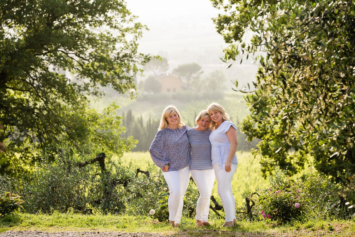 Mother and daughters portrait during a photoshoot in Tuscany