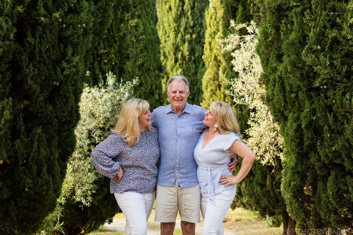 Father and daughters portrait during a family photoshoot in Tuscany