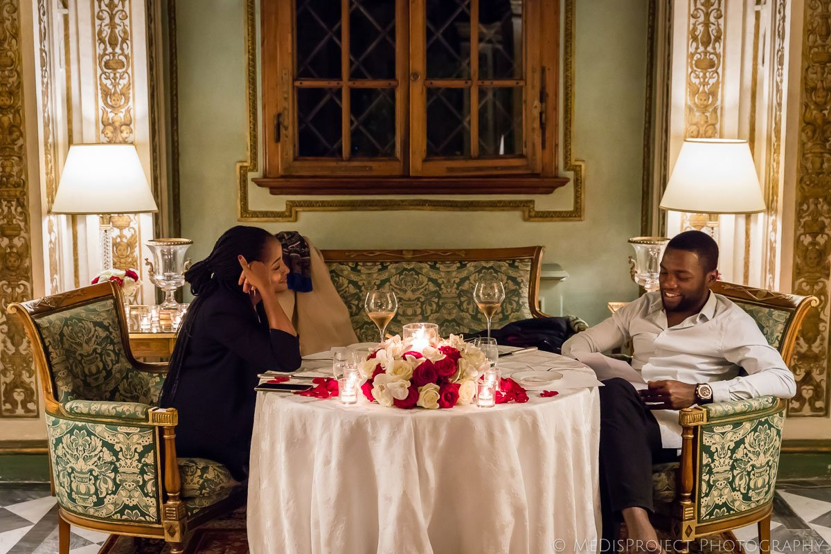 African American couple having a romantic dinner at the Four Seasons hotel in Florence Italy