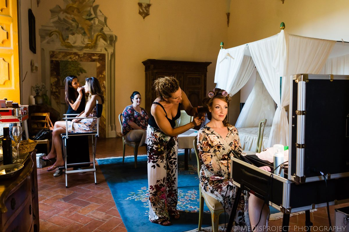 Bride and bridal party getting ready for wedding at Meleto Castle