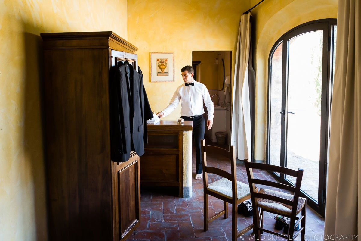 Groom getting ready for wedding in Tuscany