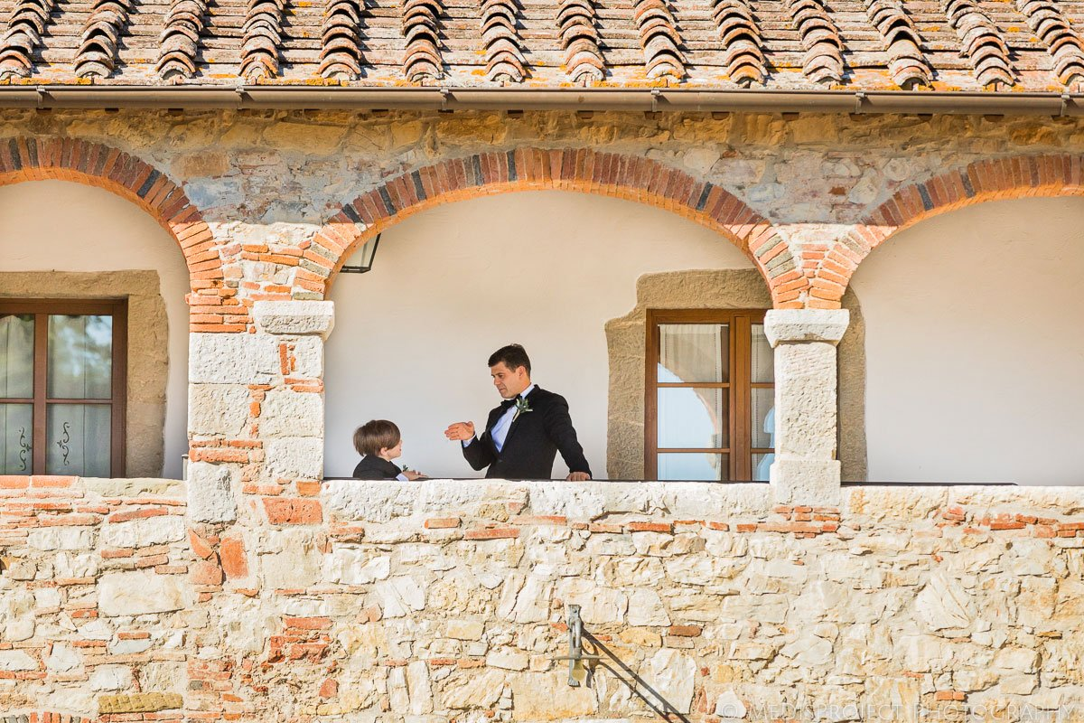 Groom and his son waiting for the wedding ceremony