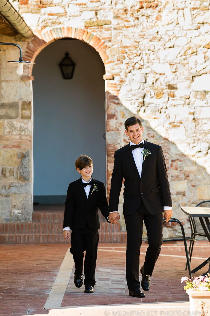 Groom and his little son waiting for the wedding ceremony