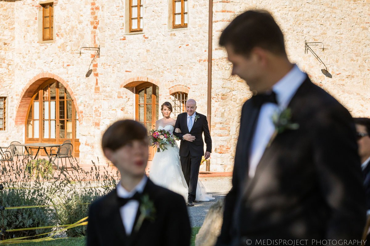 The bride walks down the aisle with her dad