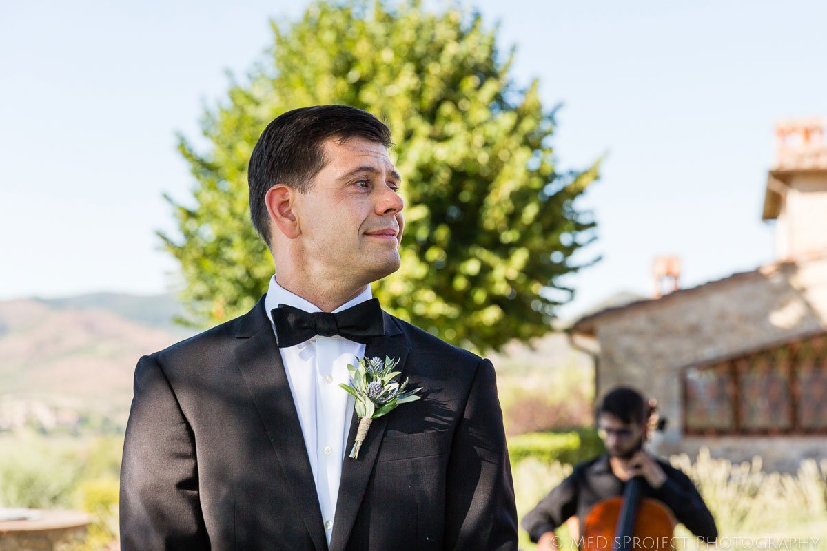 the groom's first look to the bride as she walks down the aisle