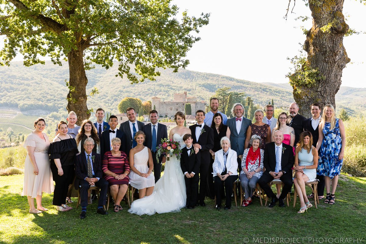 Wedding group picture at Meleto Castle in Tuscany