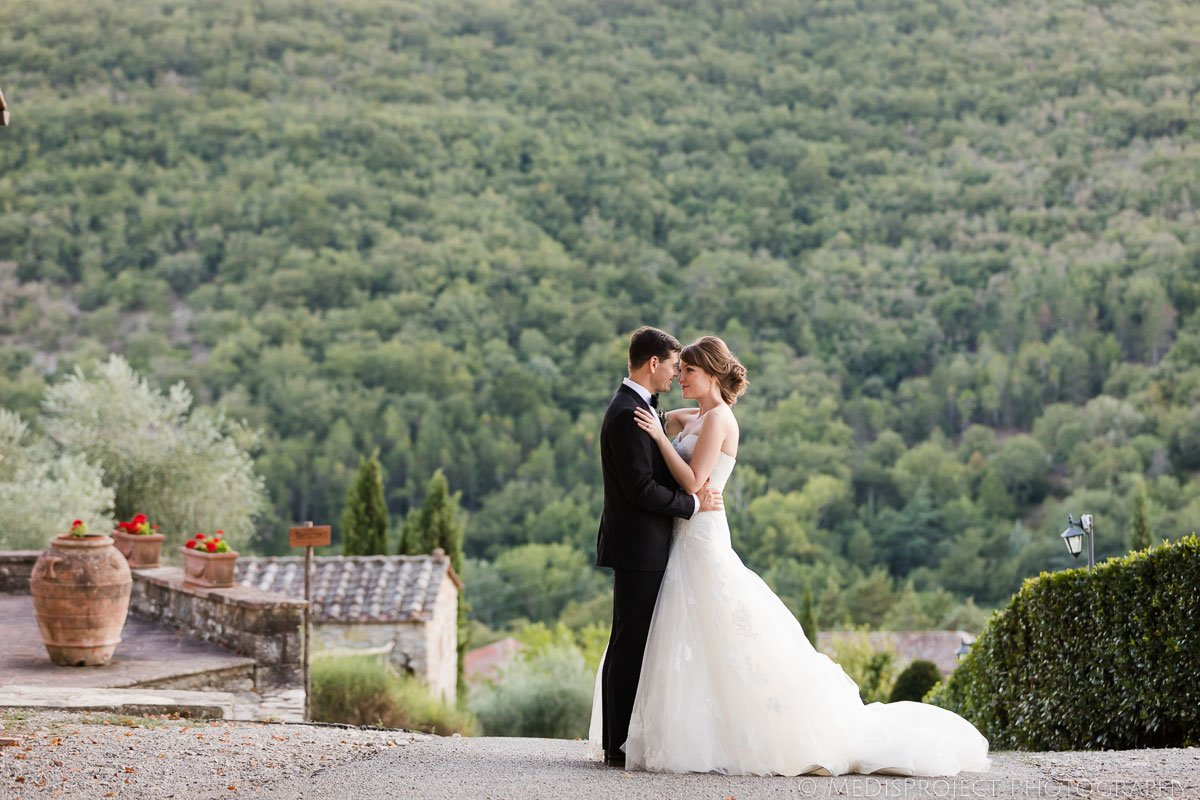 bride and groom romantic moment at Meleto Castle