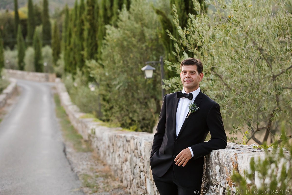 Groom's portrait wearing black tuxedo