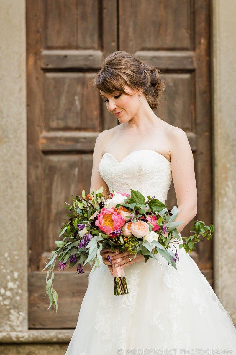 bridal portrait in front of an old wooden door