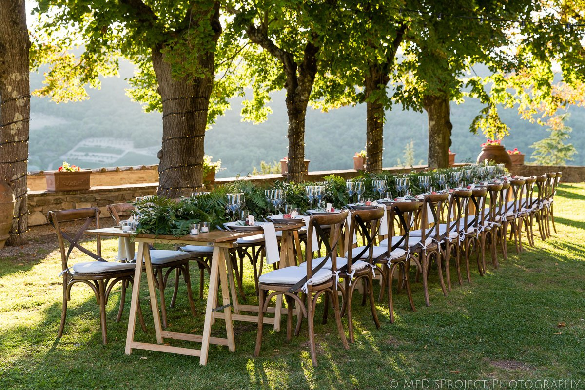 Wedding dinner table setup under the trees