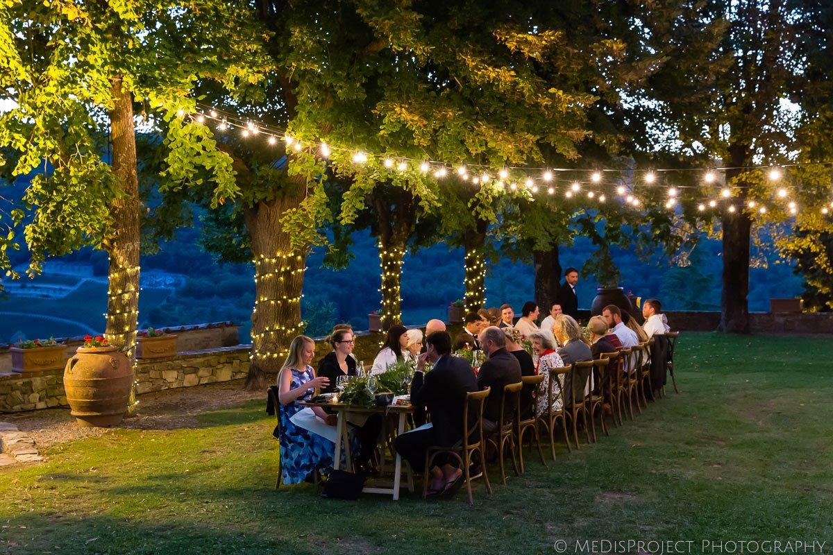 Outdoor wedding dinner at Meleto Castle