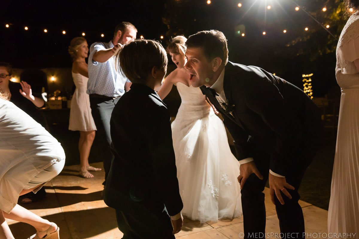 Father-son moment during the wedding party at night