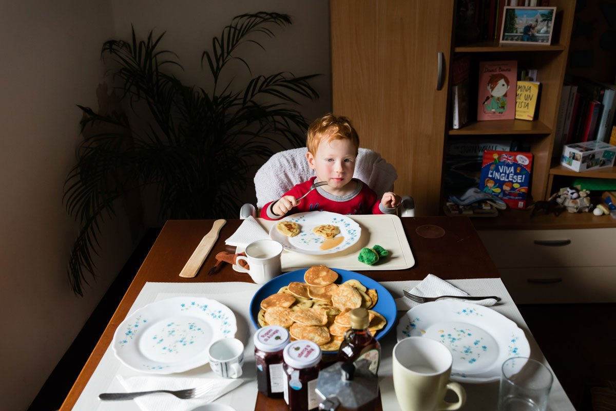 Boy eating pancakes for breakfast