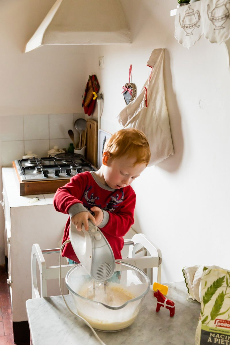 toddler preparing pancakes