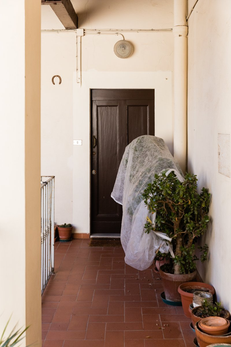 Front door of a dead person during Coronavirus lockdown in Italy