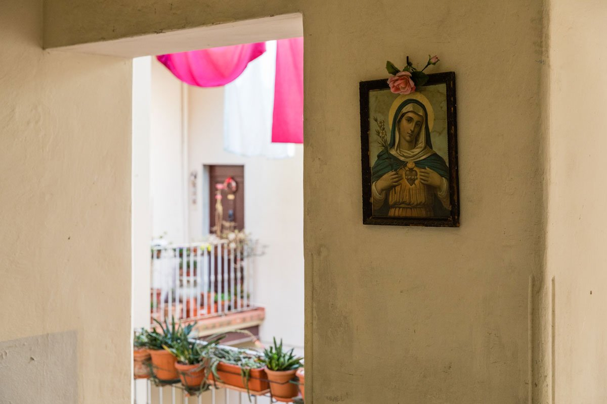 Our Lady of the Sacred Heart hanging on the wall of an Italian building