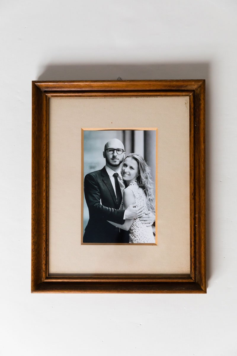 Black and white framed picture of a just married couple