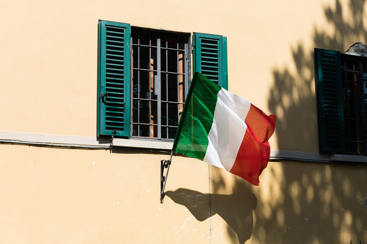 Italian flag in front of a building in Florence to celebrate the 25th of April