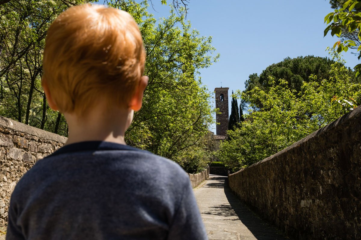 Little boy listening to midday bells in San Felice a Ema