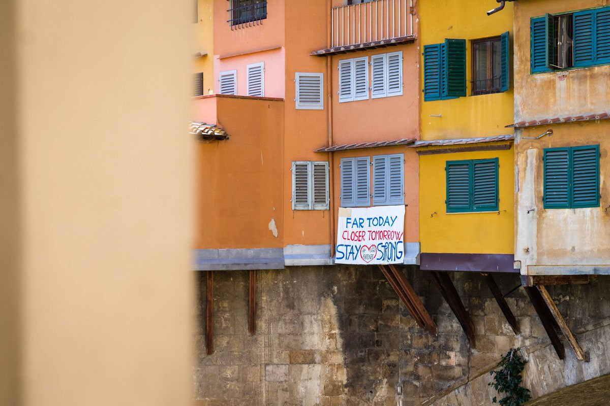 banner hanging on Ponte Vecchio in Florence during Covid19 lockdown