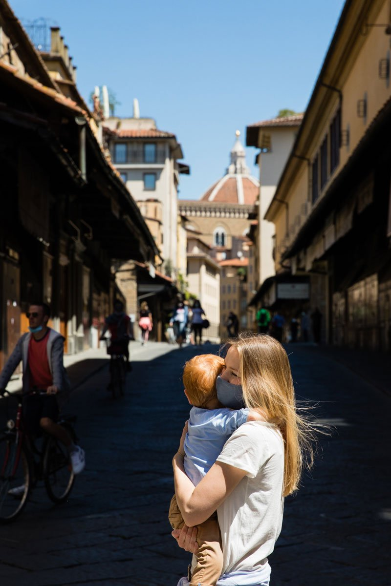Mother and son in Florence Italy during Covid19 pandemic