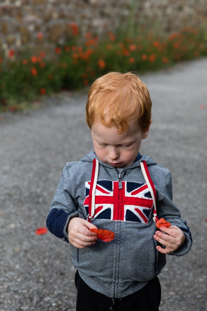 a ginger head boy wearing a jumper with union jack flag