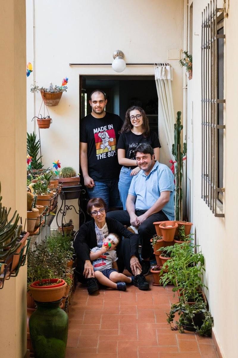 Italian family portrait in front of the door