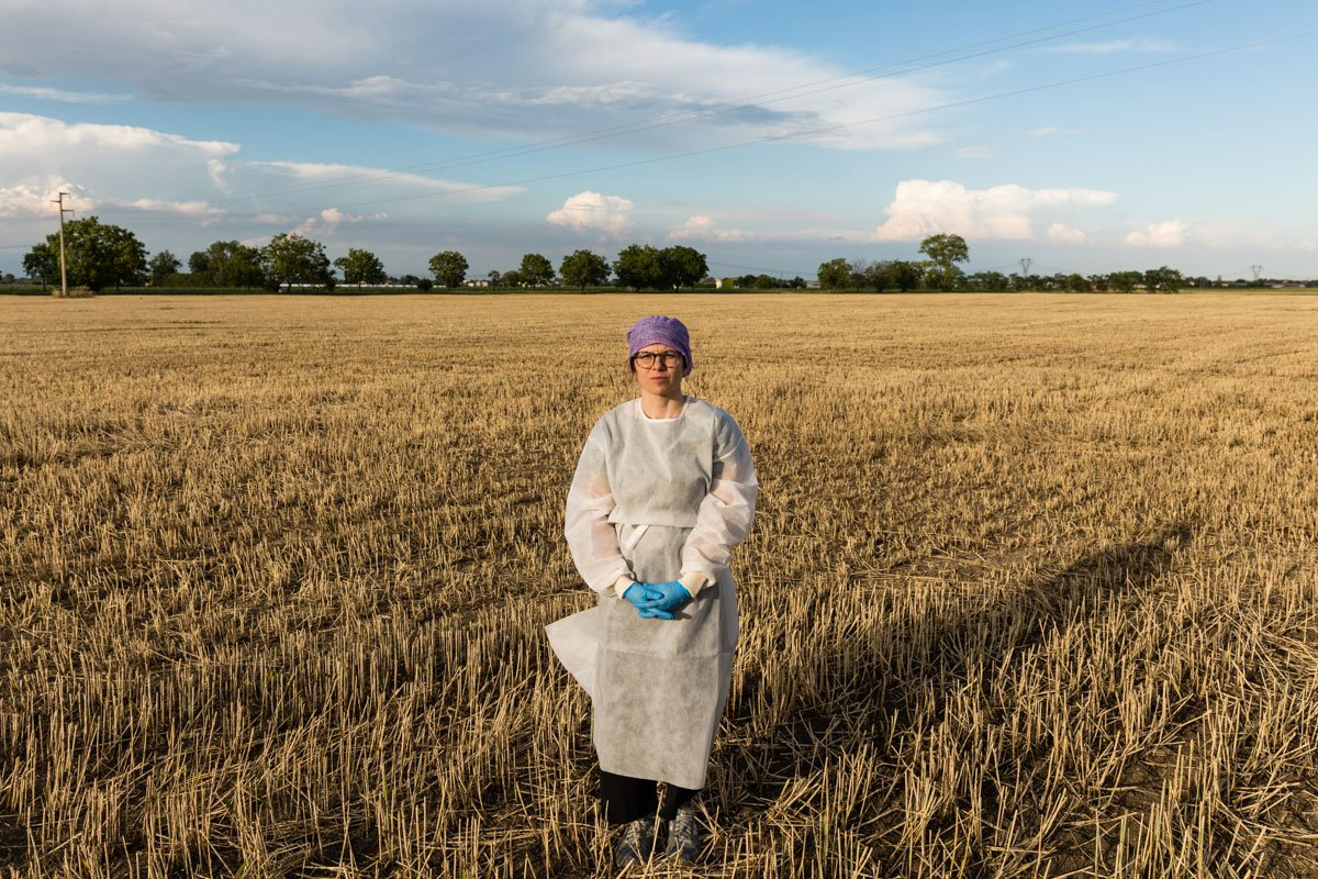 Portrait of a female doctor in a stubble field of Piacenza province