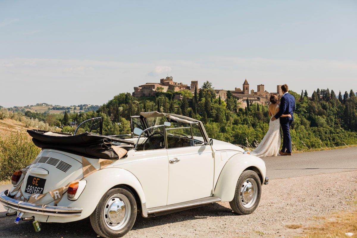 Old Volkswagen beetle and wedding couple in Certaldo