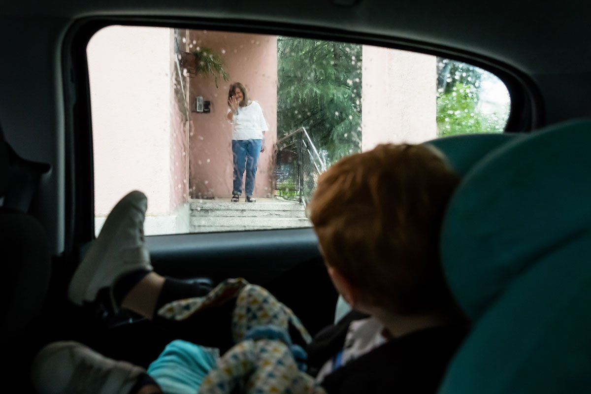 Family meets grandmother on a rainy day after Coronavirus lockdown