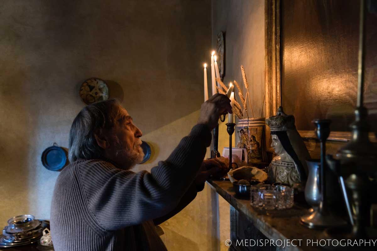 Vittorio Cipolla lighting candles at Casa dell'Abate Naldi