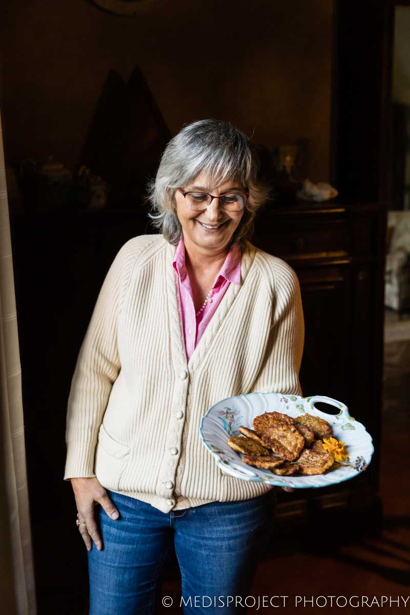 Lorenza offering home-made oat pancakes to her guests at Casa dell'Abate Naldi