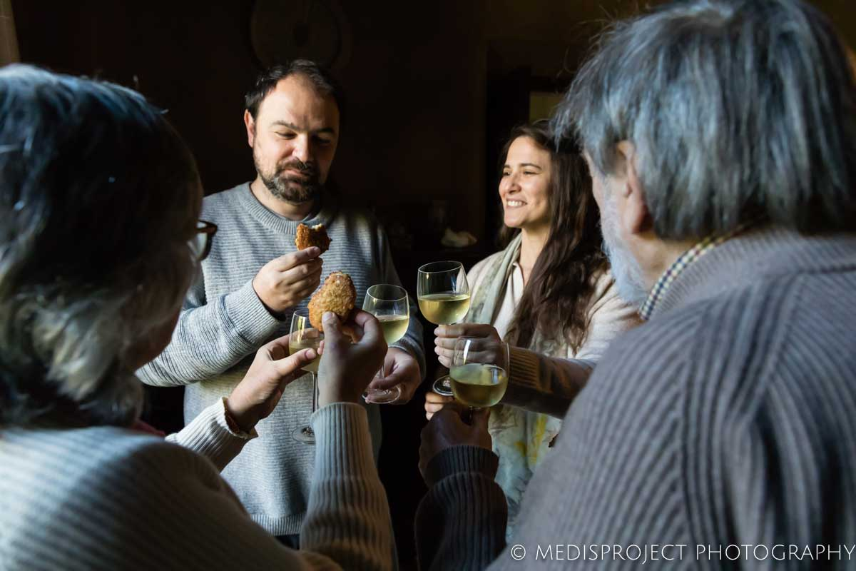 Lorenza and Vittorio toasting with a couple of guests at Casa dell'Abate Naldi