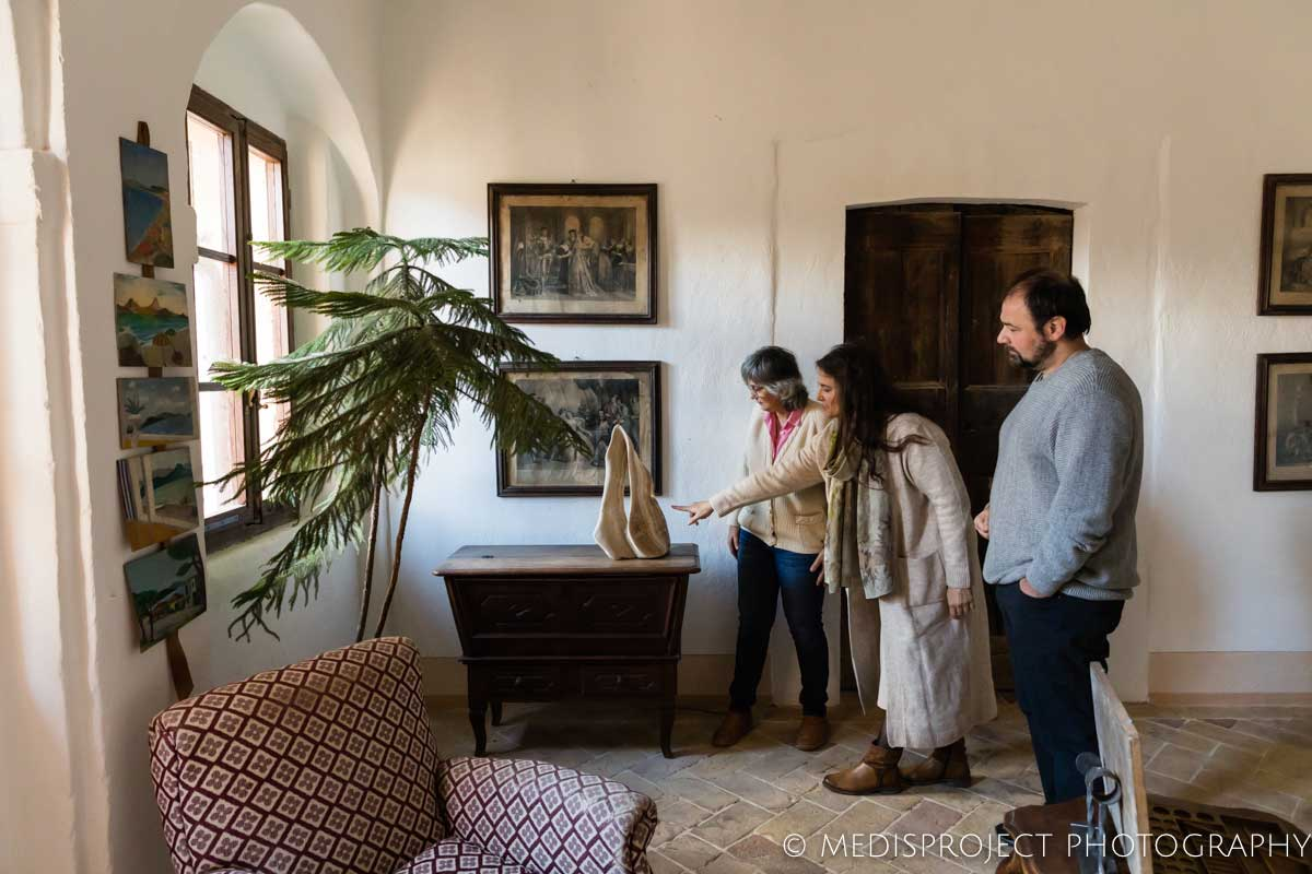Lorenza Santo showing Casa dell'Abate Naldi to a couple of guests