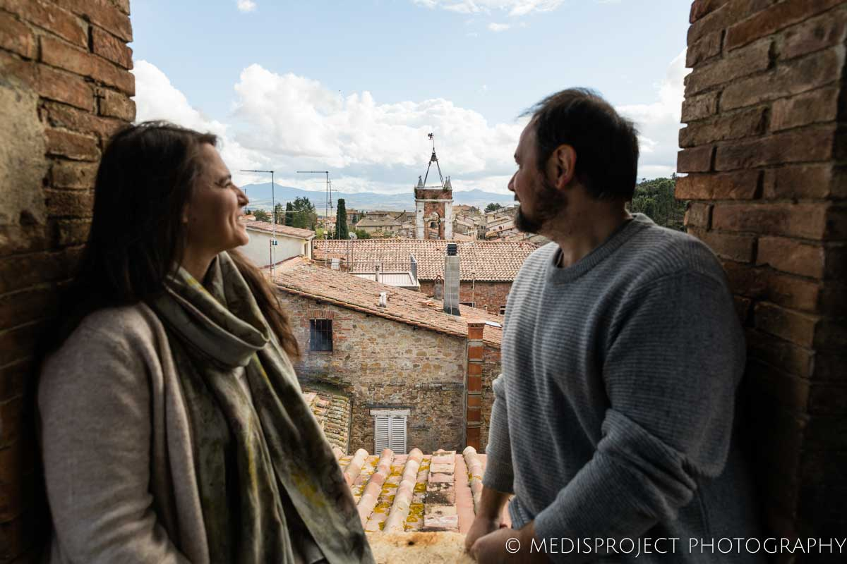 couple overlooking the rooftops of San Quirico d'Orcia