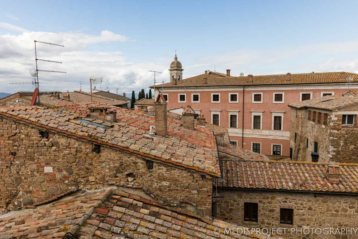 window overlooking the rooftops of San Quirico d'Orcia