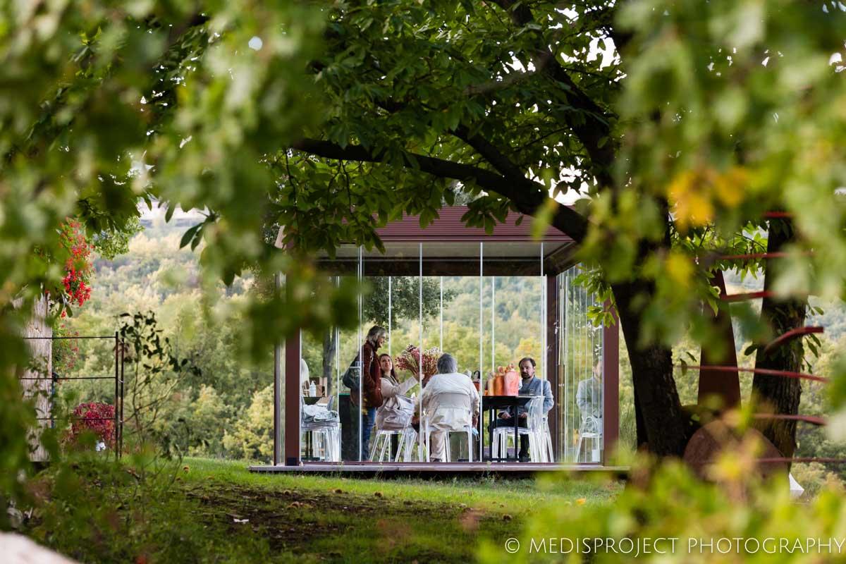 people sitting inside the glass gazebo at NostraVita's winery