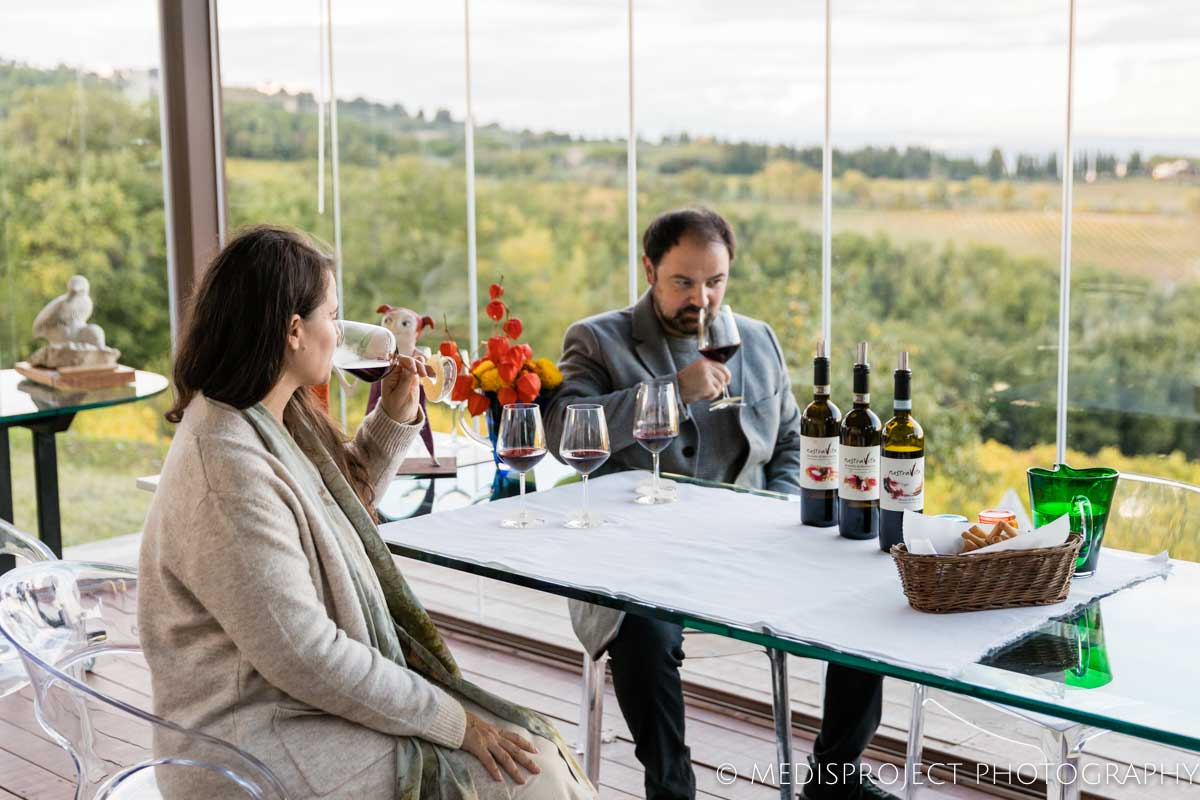 couple tasting red wine at NostraVita winery
