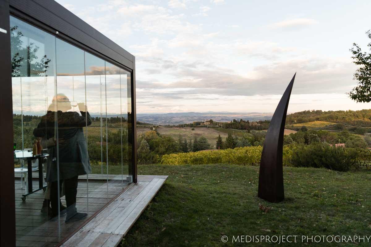 A couple drinking wine at NostraVita winery's glass gazebo