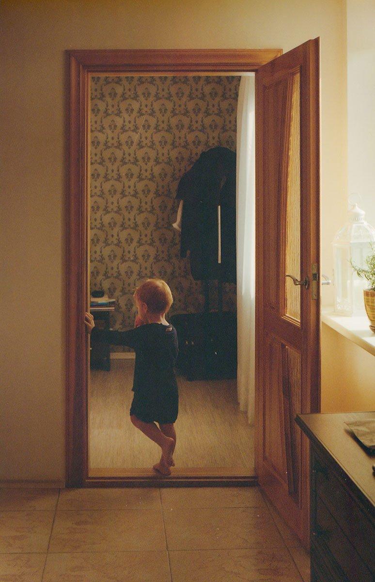 kid standing on the doorstep