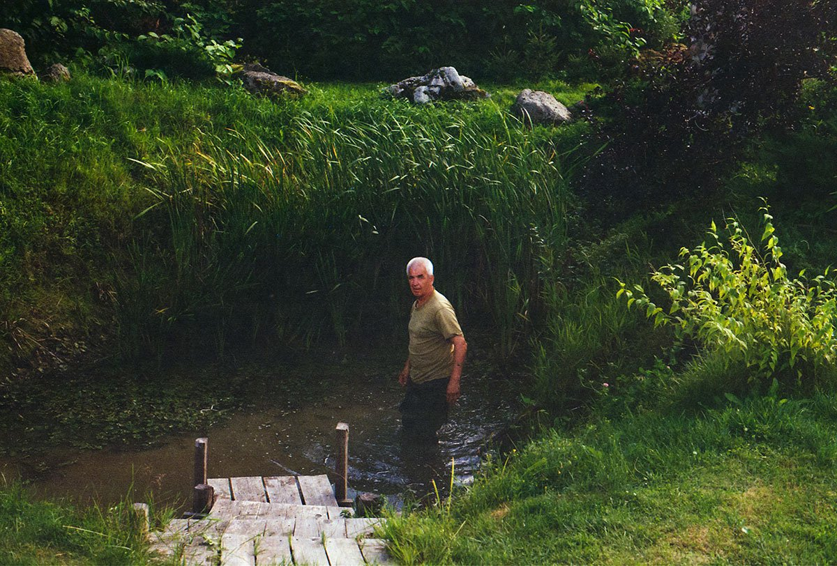 man standing in a shallow pond