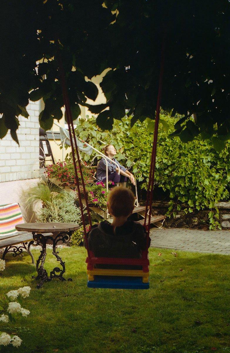 kid on a swing in the garden