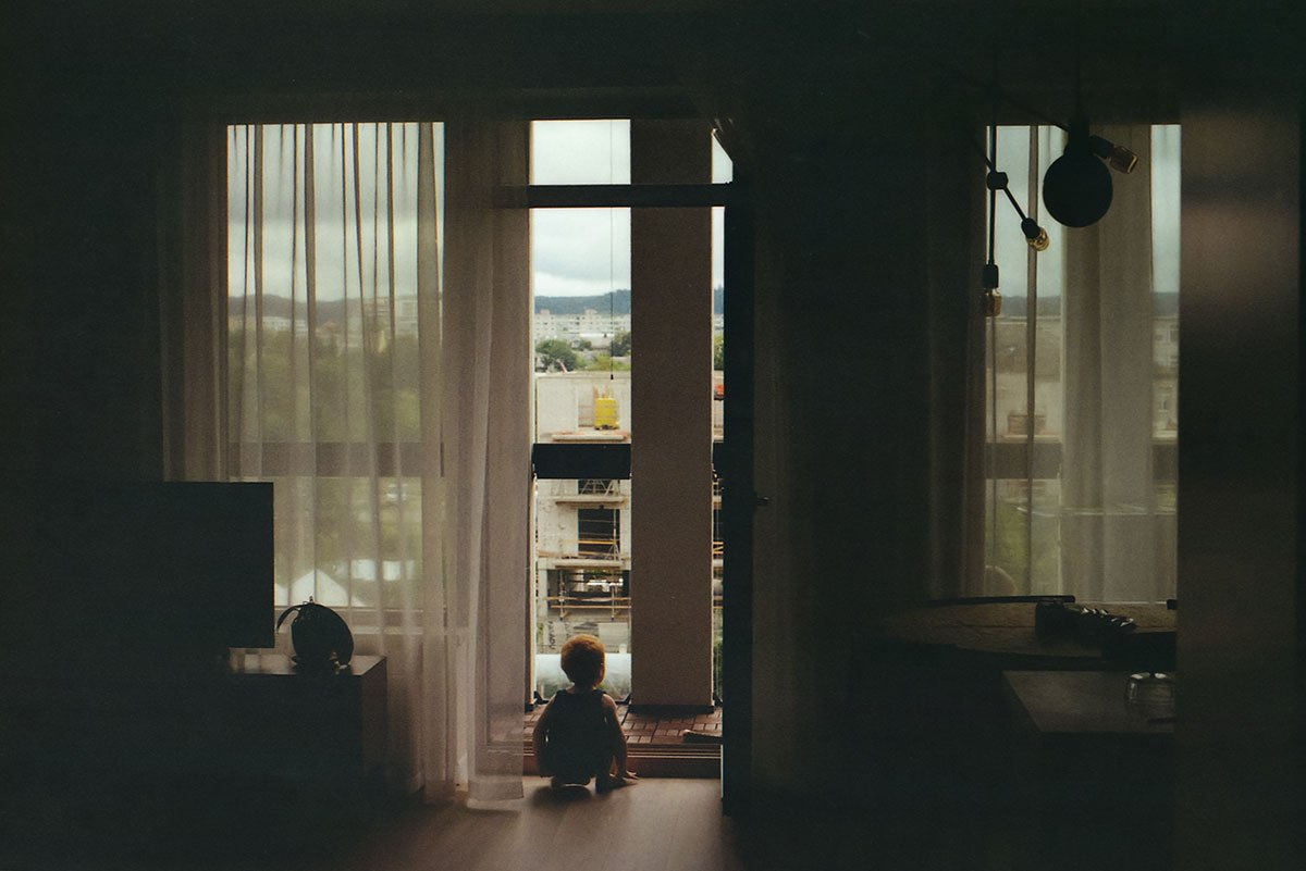 a kid looking outside the window