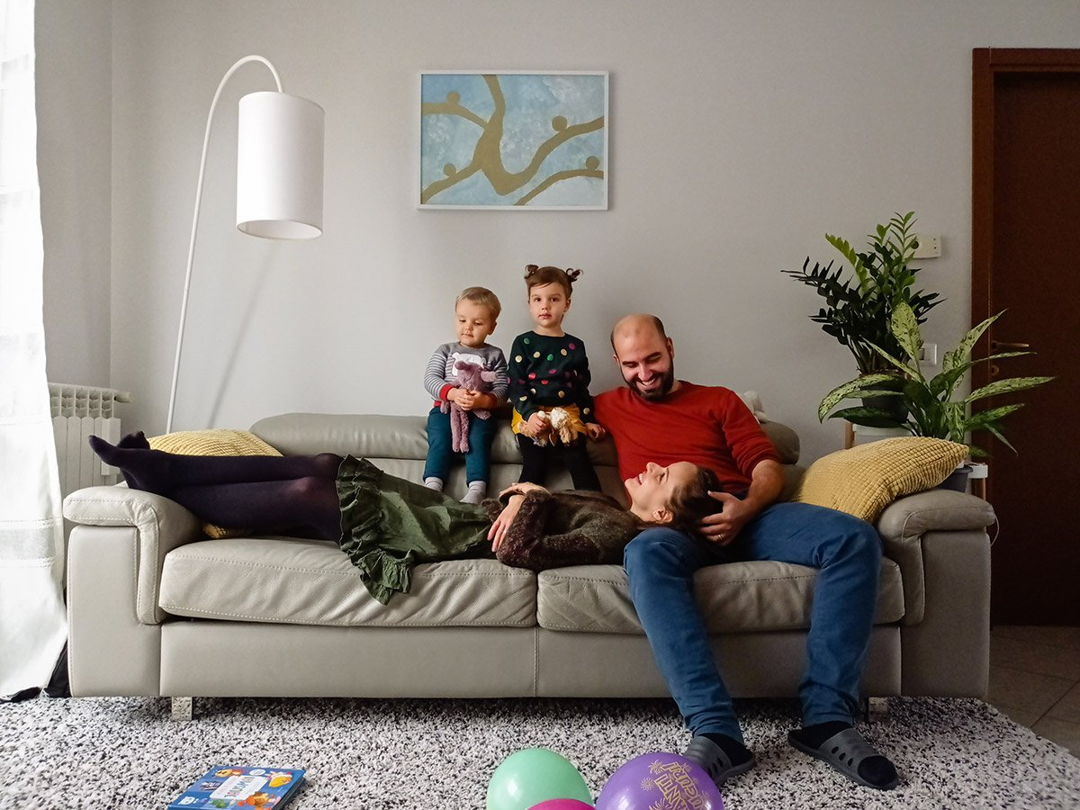 remote family portrait in a bright Italian house