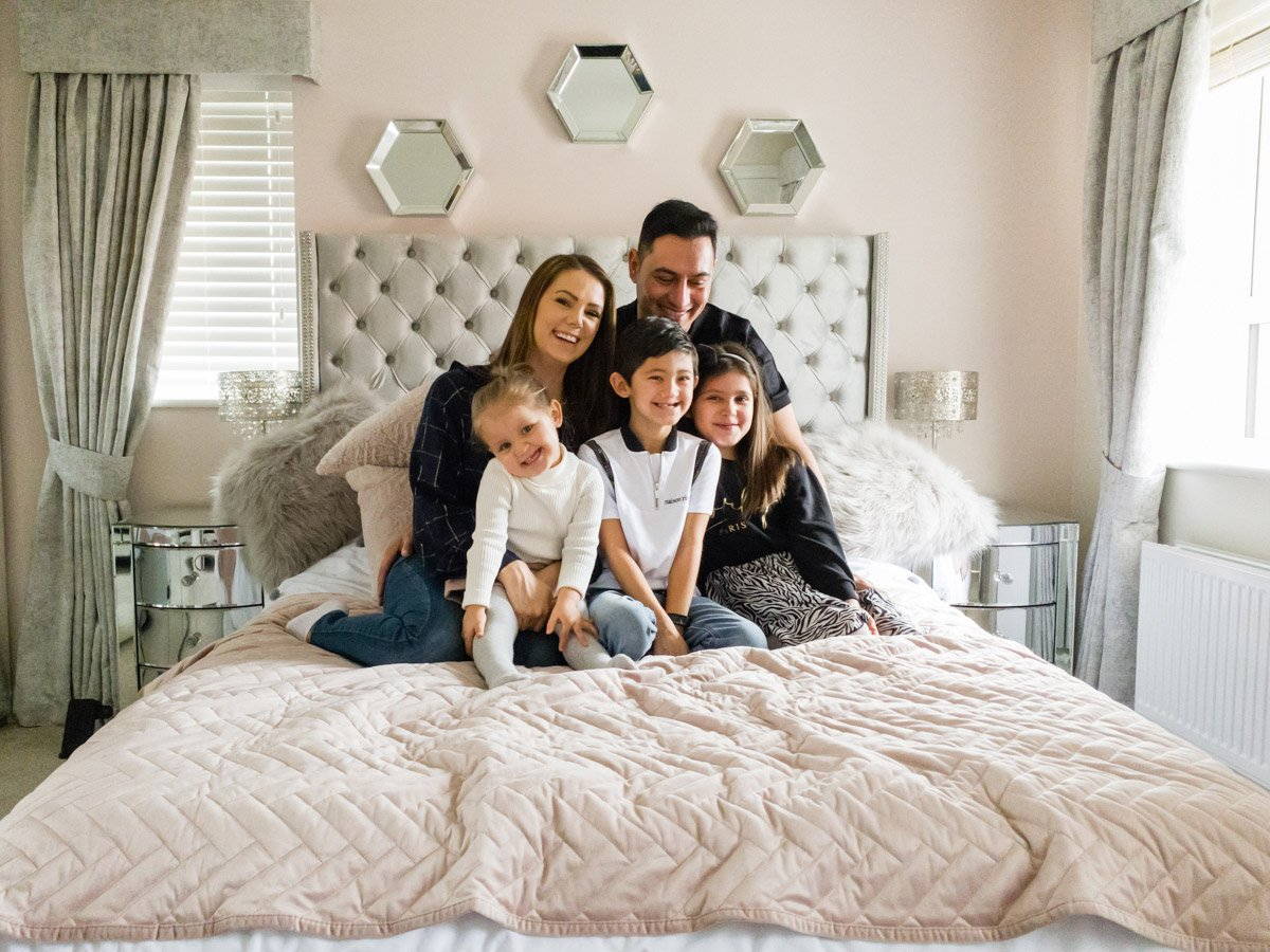 Online family portrait on a bed