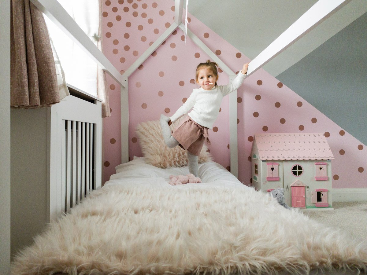 online photo of a girl in her pink room