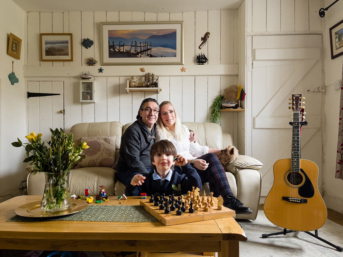 Online family portrait at home with guitar and pet