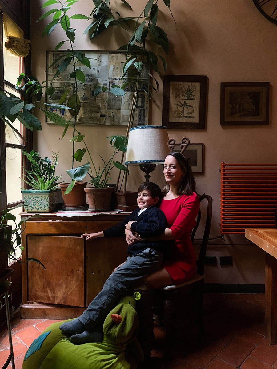 remote portrait of a woman and her son at home